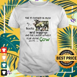 She is clothed in muck boots and leggings and she laughs without fear at the cow shirt